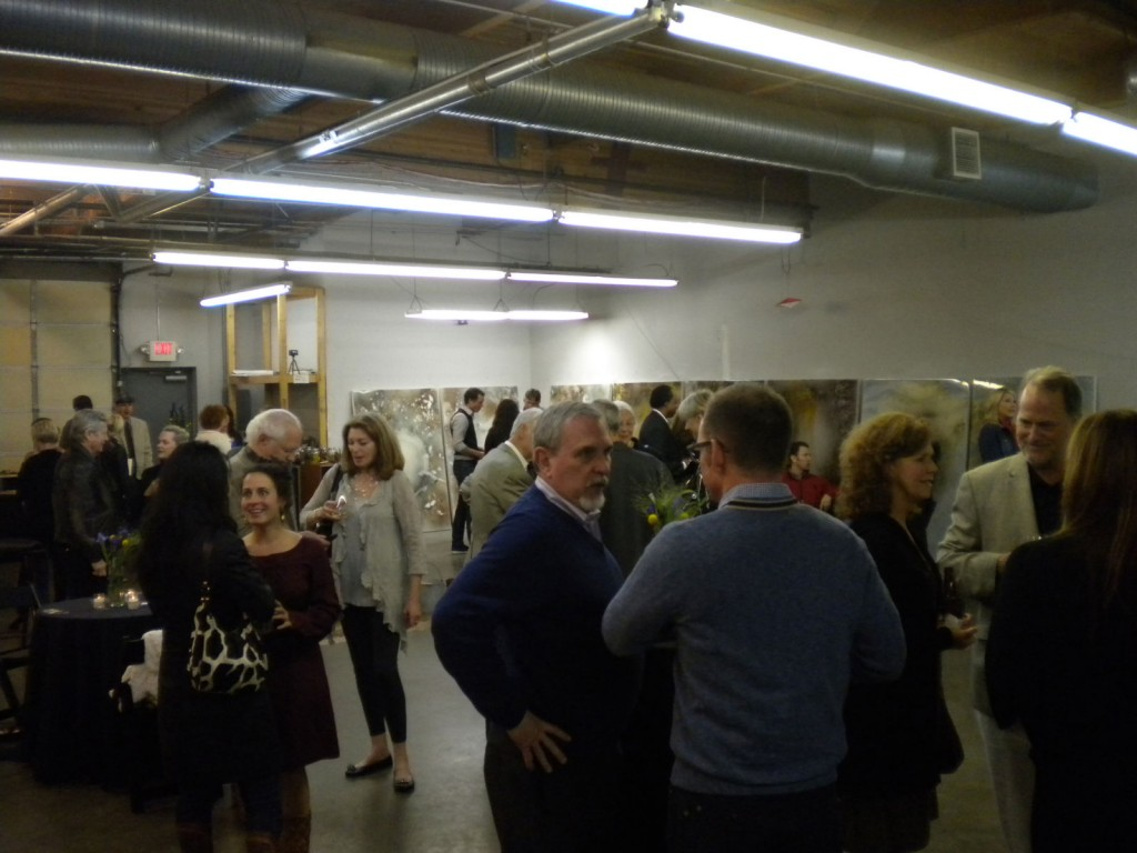 The crowd at the reception in the donated workspace in West Seattle